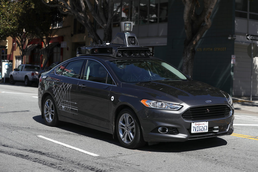 An Uber self-driving car drives down 5th Street on March 28, 2017 in San Francisco, California. Cars in Uber's self-driving cars are back on the roads after the program was temporarily halted following a crash in Tempe, Arizona on Friday. Photo by Justin Sullivan/Getty Images