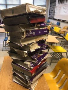 A stack of books still used by students in the English classroom of Sarah Jane Scarberry, teacher at Heavener High School in Heavener, Oklahoma. Photo provided by Sarah Jane Scarberry