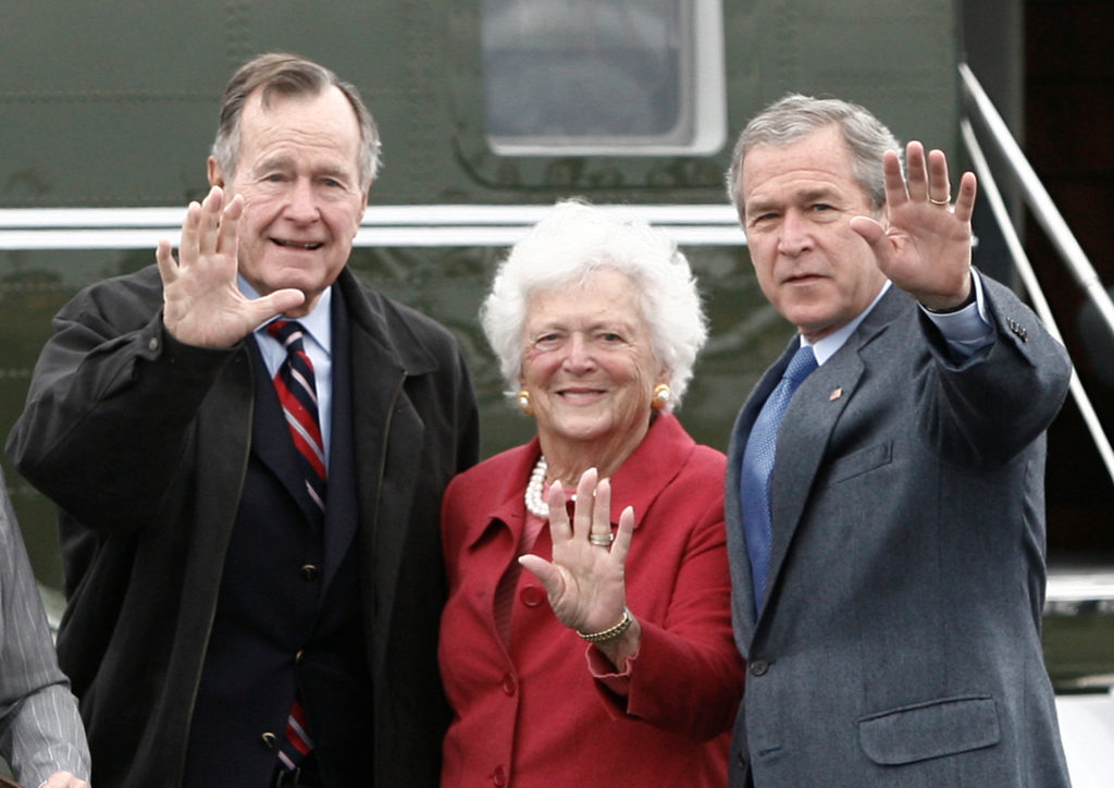 FILE PHOTO: U.S. President George W. Bush (R) waves alongside his parents, former President George Bush and former first lady Barbara Bush upon their arrival Fort Hood, Texas, April 8, 2007. Bush and his family arrived at the Army Base to attend Easter Sunday church service before returning to his ranch in Crawford.     REUTERS/Jason Reed /File Photo     TPX IMAGES OF THE DAY - RC1AAEDBB980