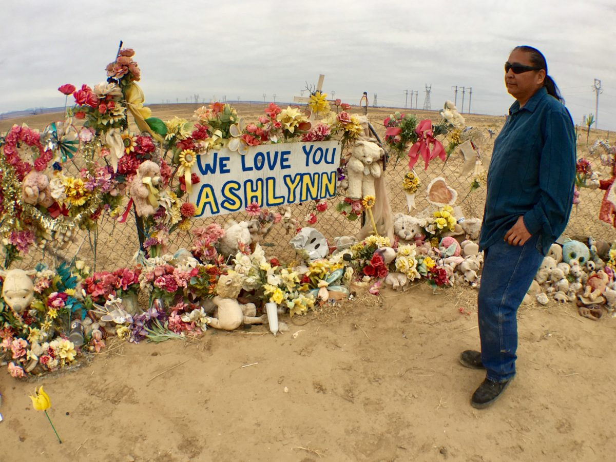 Gary Mike stands at a memorial for his daughter Ashlynne, who was killed on the Navajo Indian Reservation. Photo by Jenni Monet