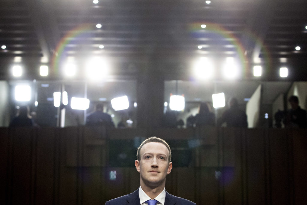Mark Zuckerberg, chief executive officer and founder of Facebook Inc., listens during a joint hearing of the Senate Judici...