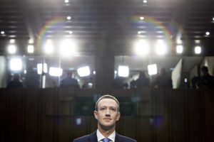 Mark Zuckerberg, chief executive officer and founder of Facebook Inc., listens during a joint hearing of the Senate Judiciary and Commerce Committees in Washington, D.C., U.S., on Tuesday, April 10, 2018. Zuckerberg said Tuesday that his company is cooperating with Special Counsel Robert Mueller in his investigation of Russian interference in the 2016 presidential election. Photographer: Andrew Harrer/Bloomberg via Getty Images