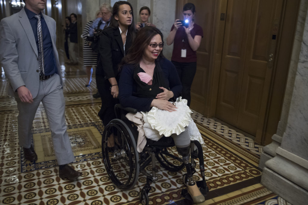 Sen. Tammy Duckworth, D-Ill., brings her baby, Maile Pearl, into the Capitol for a vote. Earlier in the week, a resolution was passed to allow children younger than one-year-old onto the Senate floor for votes. Photo By Tom Williams/CQ Roll Call
