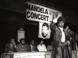 Winnie Mandela raises her fist in a black power salute after announcing that a massive pop concert will be held to mark the 70th birthday of her husband, jailed black nationalist leader Nelson Mandela on July 17, 1988. REUTERS/Wendy Schwegmann - GF2DUJAPZRAF