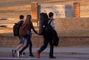 Students arrive for class at Columbine High School before participating in a National School Walkout to honor the 17 students and staff members killed at Marjory Stoneman Douglas High School in Parkland, Florida, in Littleton, Colorado. Photo by Rick Wilking/Reuters
