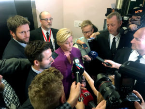 Reporters surround Norwegian Finance Minister Siv Jensen at the Norwegian Parliament in Oslo in this March 19 file photo. Photo by Joachim Dagenborg/Reuters