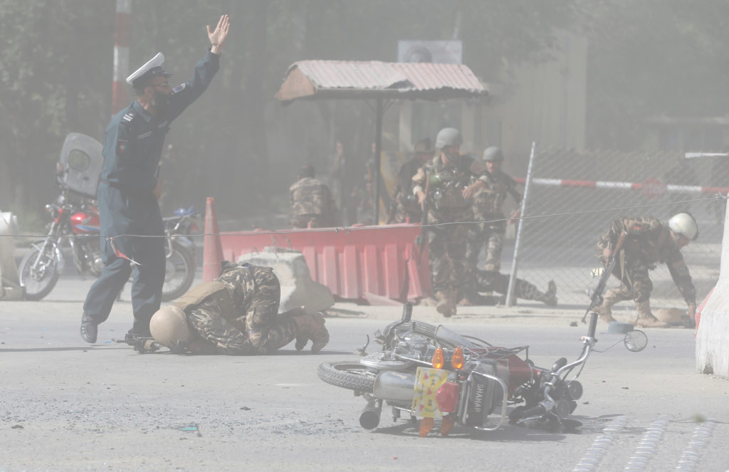 Afghan security forces are seen at the site of a second blast in Kabul, Afghanistan. Photo by Omar Sobhani/Reuters