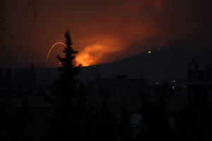 Fire and explosions are seen in what purported to be the Mountain 47 region, countryside south of Hama city, Syria, April 29, 2018 in this picture obtained from social media. Abody Ahfad Khaled /via REUTERS THIS IMAGE HAS BEEN SUPPLIED BY A THIRD PARTY. MANDATORY CREDIT. NO RESALES. NO ARCHIVES. MANDATORY CREDIT. CREDIT: ABODY AHFAD KHALED - RC1C60322B50