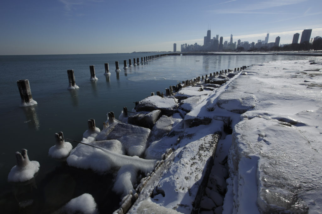 Ice covers the shore of Lake Michigan in Chicago, December 12, 2013. REUTERS/John Gress