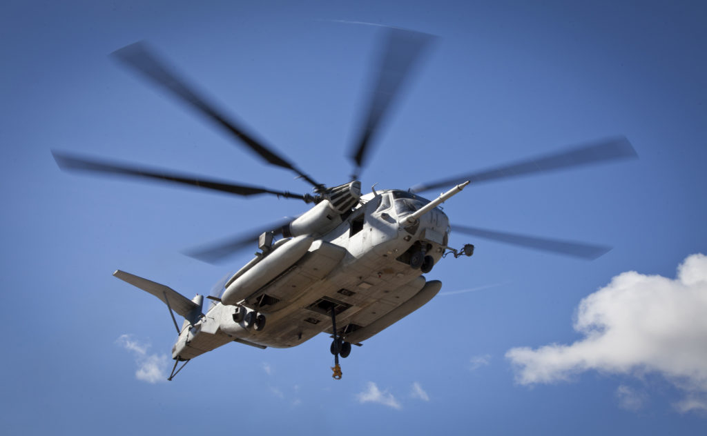 A CH-53E Super Stallion, used by the Marine Heavy Helicopter Squadron 463, prepares to carry off a U.S. Army Huey Helicopter on Sept. 23, 2014. Photo by Marines credit via Reuters