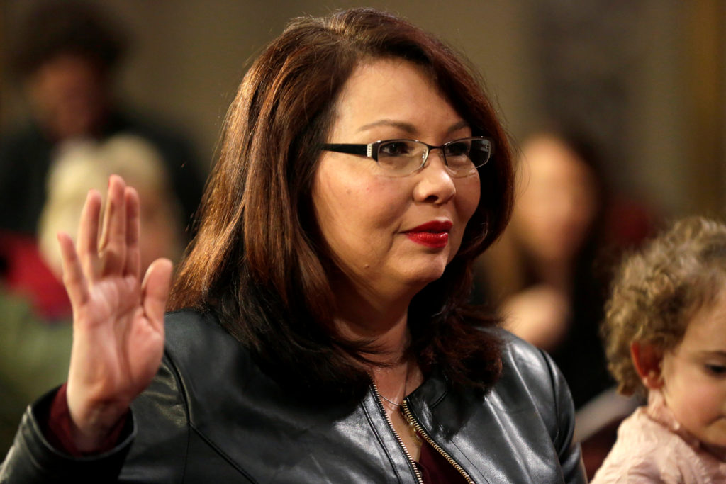 Sen. Tammy Duckworth (D-Ill.) participates in a 2017 mock swearing-in during the opening day of the 115th Congress on Capitol Hill in Washington, D.C. Photo by Joshua Roberts/Reuters