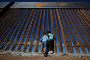 Children play at a newly built section of the U.S.-Mexico border wall. Photo by REUTERS/Jose Luis Gonzalez