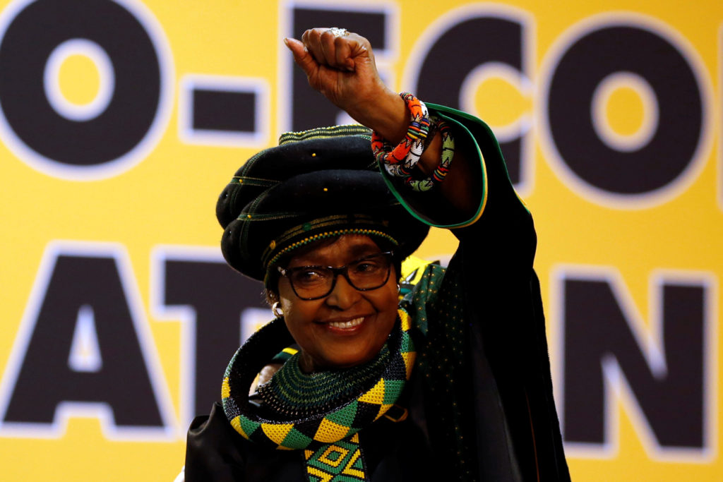 Winnie Madikizela Mandela, ex-wife of former South African president Nelson Mandela, gestures to supporters at the 54th Na...
