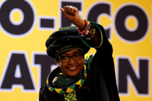 Winnie Madikizela Mandela, ex-wife of former South African president Nelson Mandela, gestures to supporters at the 54th National Conference of the ruling African National Congress (ANC) at the Nasrec Expo Centre in Johannesburg, South Africa, in December 2017. Photo by Siphiwe Sibeko/Reuters
