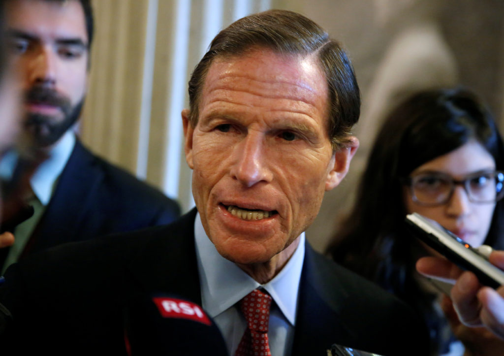 Senator Senator Richard Blumenthal (D-CT) speaks to reporters after the Senate reached an agreement to end the shut down of the federal government on Capitol Hill in Washington, U.S., January 22, 2018.      REUTERS/Joshua Roberts - RC19E1619100