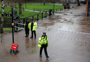 Police officers stand on March 28 near the site where former Russian intelligence officer Sergei Skripal and his daughter Yulia were found poisoned in Salisbury, Britain. Photo by Peter Nicholls/Reuters