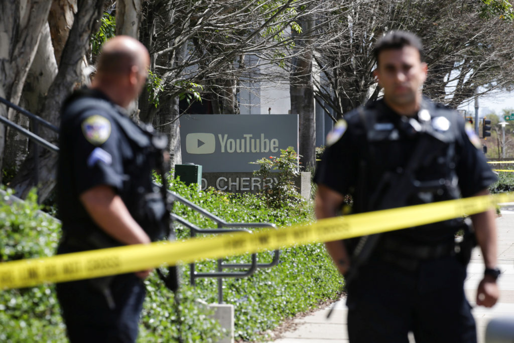 Police officers and crime scene tape are seen at YouTube headquarters following an active shooter situation in San Bruno, California. Photo by Elijah Nouvelage/Reuters