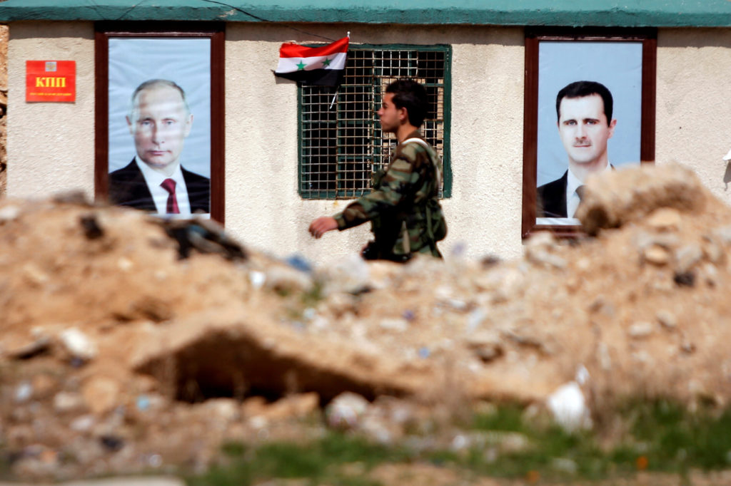 FILE PHOTO: A Syrian soldier loyal to President Bashar al Assad is seen outside eastern Ghouta, in Damascus, Syria Februar...