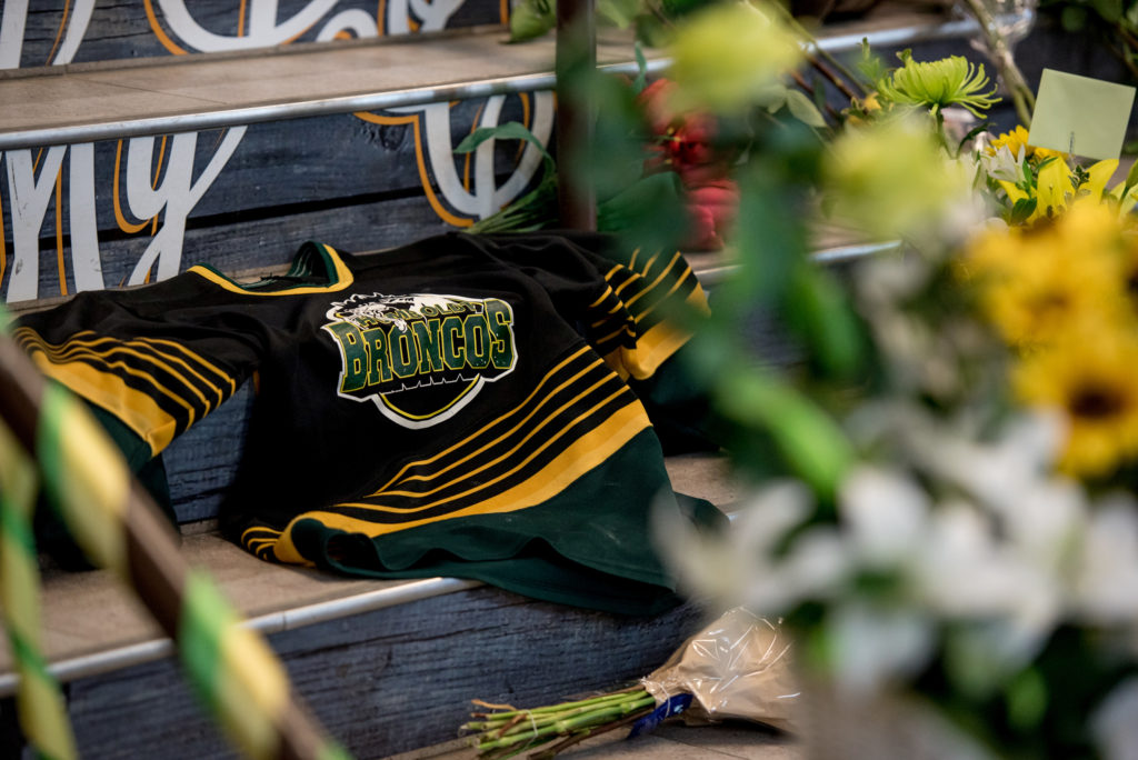 A Humboldt Broncos team jersey is seen among notes and flowers at a memorial for the Humboldt Broncos team leading into the Elgar Petersen Arena in Humboldt, Saskatchewan