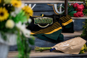 A Humboldt Broncos team jersey is seen among notes and flowers at a memorial for the Humboldt Broncos team leading into the Elgar Petersen Arena in Humboldt, Saskatchewan, Canada. Photo by Matt Smith/Reuters