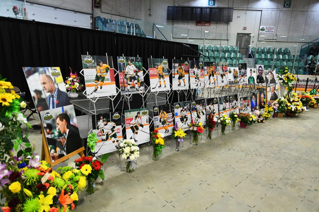 Photos of people involved in a fatal bus crash are seen before a vigil at the Elgar Petersen Arena, home of the Humboldt Broncos, in Humboldt, Saskatchewan, on April 8, 2018. Photo by Jonathan Hayward/Pool via Reuters
