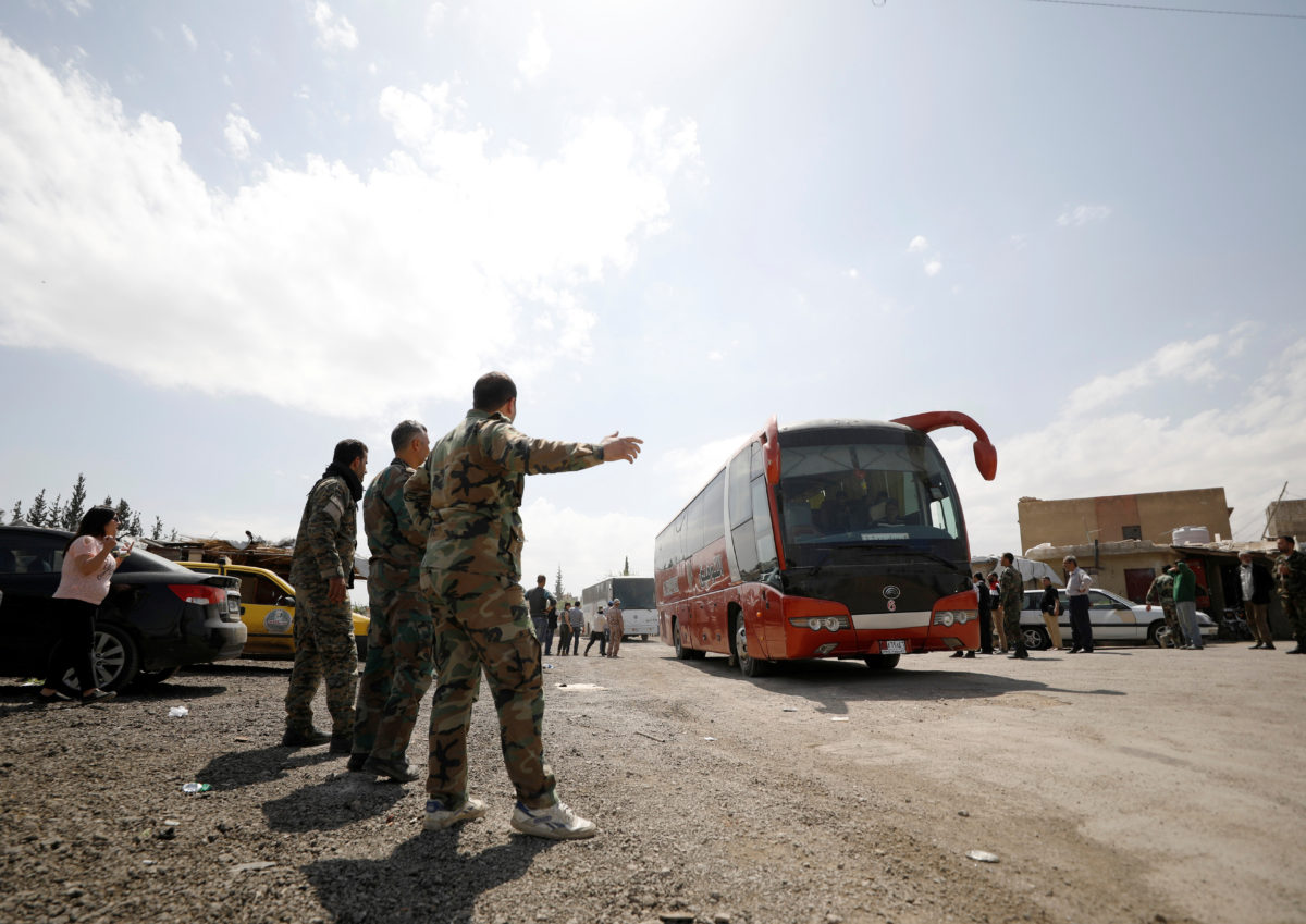 Buses carry rebels and their families who left Douma, at the Wafideen camp in Damascus, Syria, on April 9, 2018. Photo by Omar Sanadiki/Reuters