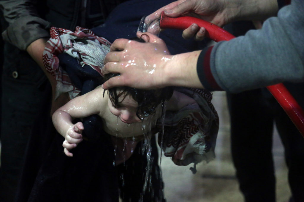 A child is treated in a hospital in Douma, eastern Ghouta in Syria, after what a Syria medical relief group claims was a suspected chemical attack on April 7. Photo by White Helmets/Handout via Reuters