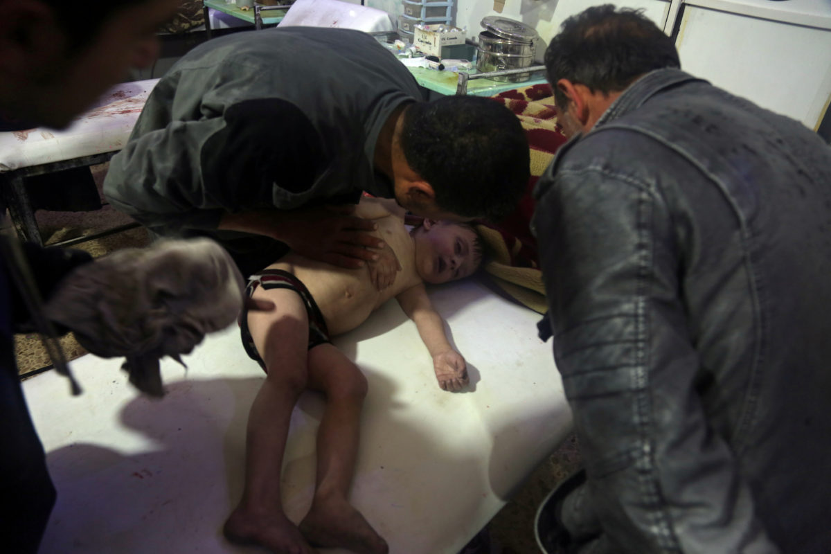 A child is treated in a hospital in Douma, eastern Ghouta in Syria, after a suspected chemical attack on April 7. White Helmets/Handout via Reuters