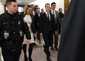 Facebook CEO Mark Zuckerberg walks to a meeting with Senator John Thune (R-SD) on Capitol Hill in Washington, U.S., April 9, 2018. REUTERS/Leah Millis - HP1EE491KXY4K