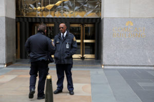 Police and security stand outside 30 Rockefeller Plaza, the location for the offices of U.S. President Donald Tump's lawyer Michael Cohen which was raided by the F.B.I. today in the Manhattan borough of New York City, New York, U.S., April 9, 2018. REUTERS/Andrew Kelly - RC15CC49E700