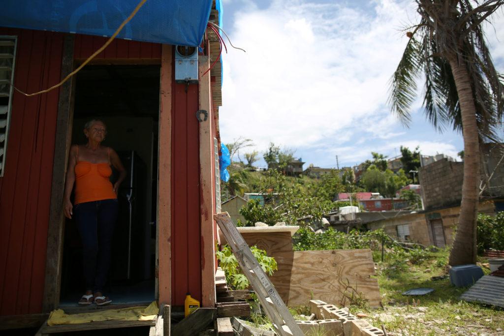 Bexaida Torres stands in the door of what is left of her home after Hurricane Maria hit the island in September, in a neighbourhood in Canovanas, Puerto Rico. Photo by Alvin Baez/Reuters
