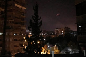 Anti-aircraft fire is seen over Damascus, Syria early April 14. Photo by Feras Makdesi/Reuters