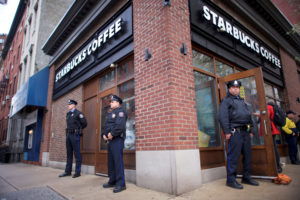 Police officers monitor activity outside as protesters demonstrate inside a Center City Starbucks, where two black men were arrested, in Philadelphia, Pennsylvania. Photo by Mark Makela/Reuters