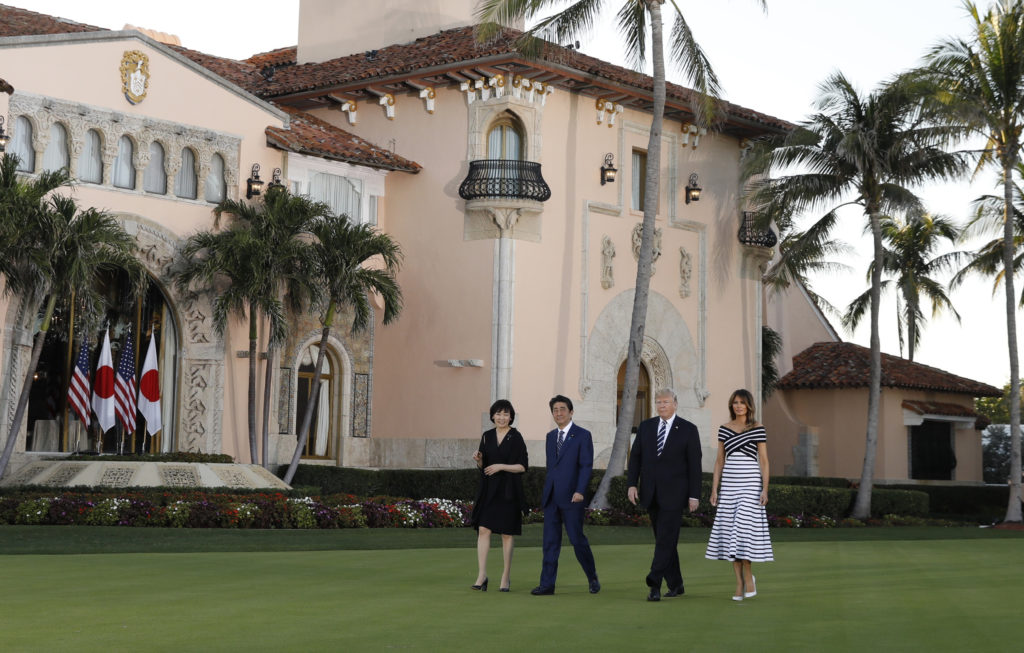 President Donald Trump and first lady Melania Trump (right) walk with Japan's Prime Minister Shinzo Abe (second from left) and Abe's wife Akie as they arrive for a dinner at Trump's Mar-a-Lago estate in Palm Beach, Florida on April 17. Photo by Kevin Lamarque/Reuters