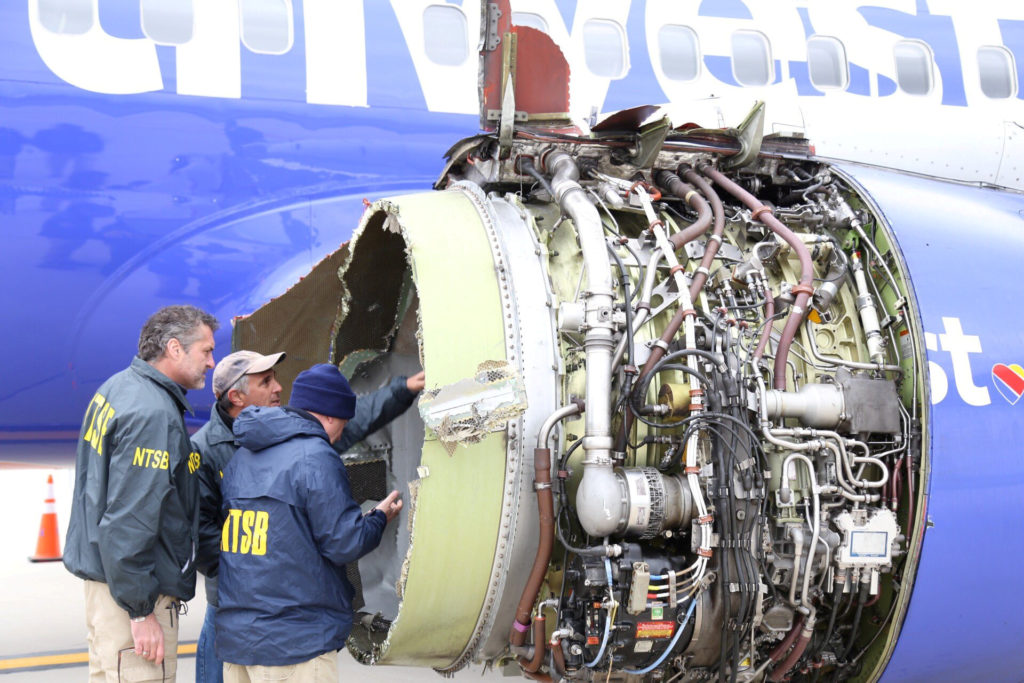 NTSB investigators are on scene examining damage to the engine of the Southwest Airlines plane in this image released from Philadelphia, Pennsylvania. Photo by NTSB via Reuters