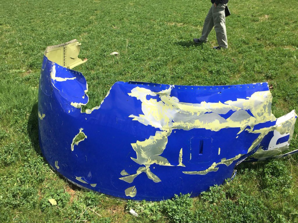 This photo shows a part of the engine cowling from the Southwest Airlines plane which blew its engine in mid-air this week over the skies of Philadelphia, Pennsylvania, in this image released on April 18, 2018. Photo by NTSB via Reuters