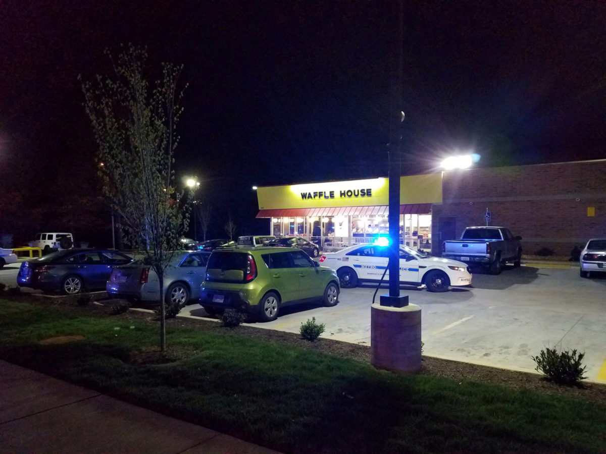A police vehicle sits parked at the scene of a fatal shooting at a Waffle House restaurant near Nashville, Tennessee. Photo by Metro Nashville Police Department via Reuters