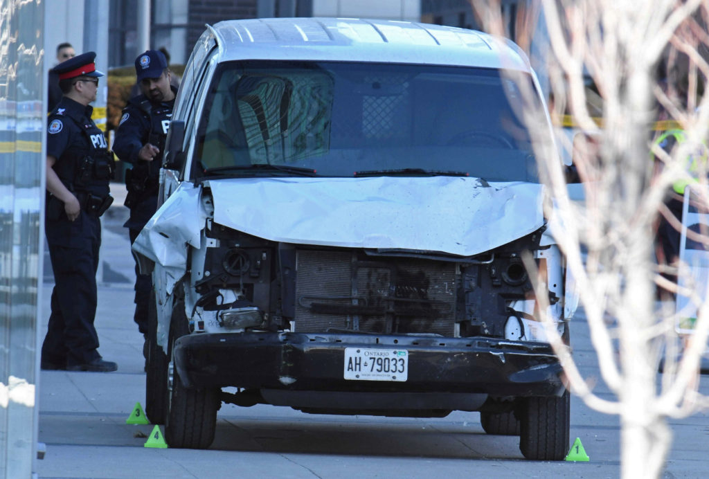 A damaged van seized by police is seen after multiple people were s…