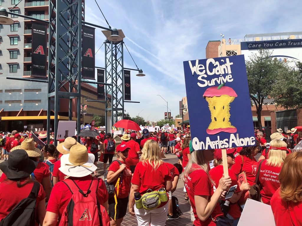 Participants take part in a march in Phoenix, Arizonia, U.S., April 26, 2018 in this picture obtained from social media. C...