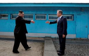 South Korean President Moon Jae-in and North Korean leader Kim Jong Un shake hands at the truce village of Panmunjom inside the demilitarized zone separating the two Koreas, South Korea, April 27, 2018. Korea Summit Press Pool/Pool via Reuters