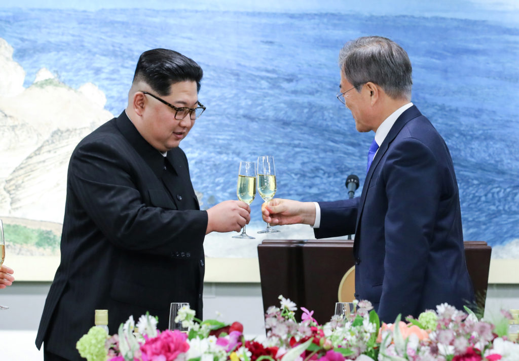 North Korean leader Kim Jong Un (left) and South Korean President Moon Jae-in share a toast in the Demilitarized Zone on April 27. Photo by Korea Summit Press Pool via Reuters