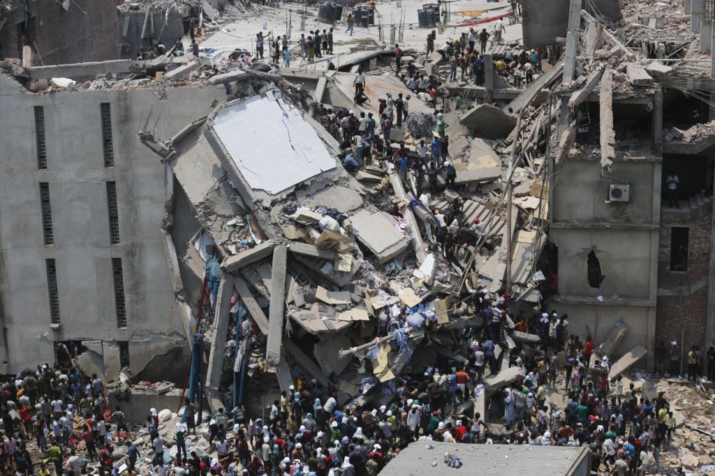 Rana Plaza, an eight-story building housing garment factories and a shopping center, collapsed on the outskirts of the Bangladeshi capital Dhaka on April 24, 2013. Photo by Andrew Biraj/Reuters