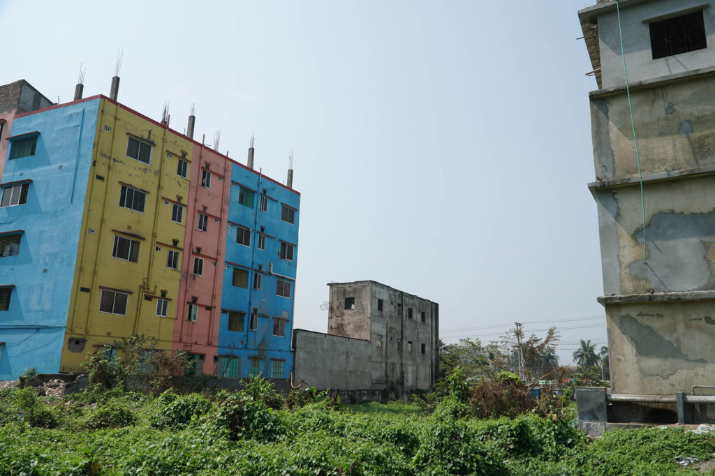 The site of the Rana Plaza building that collapsed in 2013 is now overgrown with vines. Photo by April Gu/NYU Center for Business and Human Rights