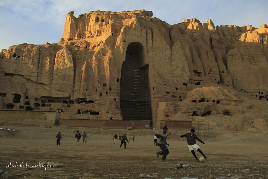 Children play soccer in Bamiyan, Afghanistan, in front of the cliffs where giant Buddhas were destroyed by the Taliban in 2001. Photo by Abdullah Sadaqat