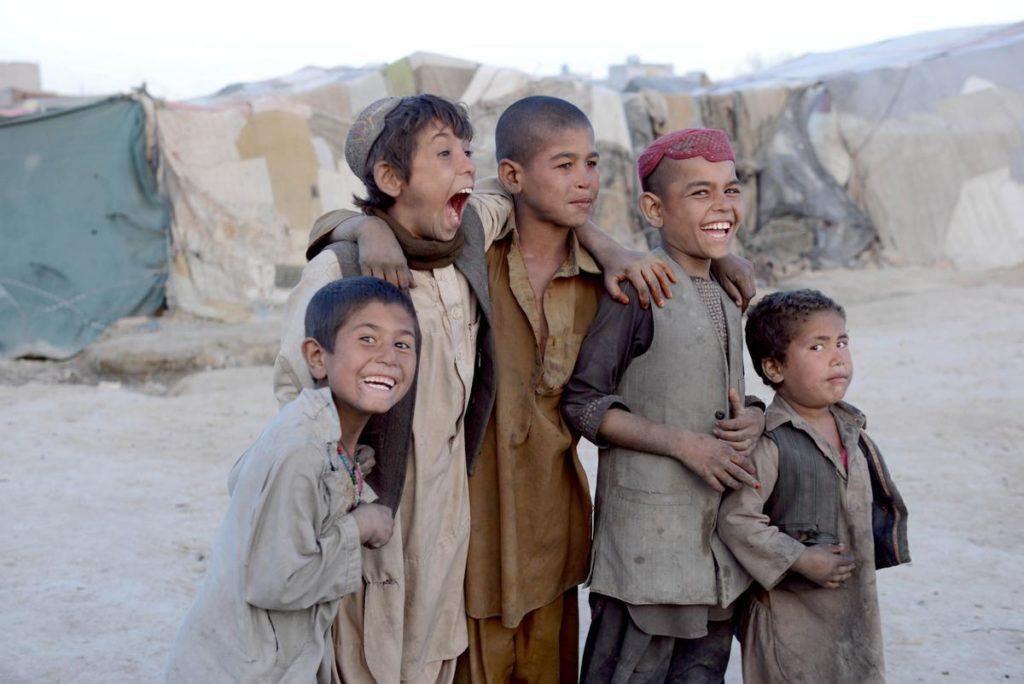 Boys living in an internally displaced camp in Kandahar, Afghanistan. Photo by Sanaullah Seiam