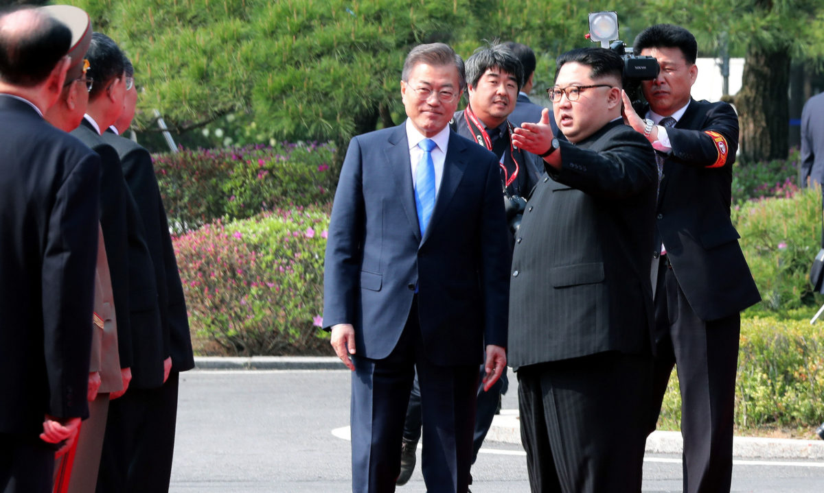 South Korean President Moon Jae-in and North Korean leader Kim Jong Un meet in the truce village of Panmunjom inside the demilitarized zone separating the two Koreas, South Korea, April 27, 2018. Korea Summit Press Pool/Pool via Reuters - RC147C9130D0