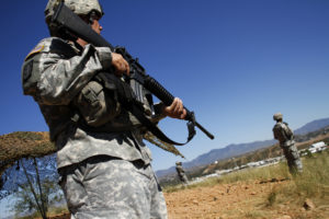 National Guard troops patrol along the U.S. and Mexico border in Nogales, Arizona, in 2010. Photo by Joshua Lott/Reuters