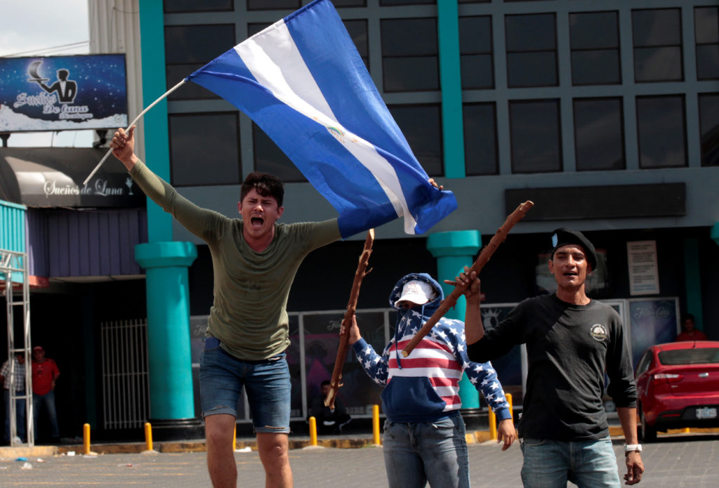 A demonstrator takes part in a protest as Nicaraguan President Daniel Ortega cancelled a planned overhaul of the welfare system in a bid to end protests in Managua, Nicaragua, April 22, 2018. REUTERS/Oswaldo Rivas