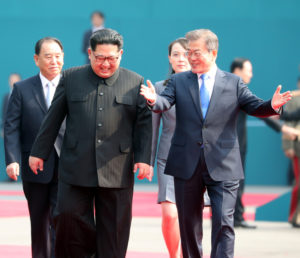 South Korean President Moon Jae-in and North Korean leader Kim Jong Un arrive at the Peace House in the truce village of Panmunjom inside the demilitarized zone separating the two Koreas, South Korea, April 27, 2018. Korea Summit Press Pool/Pool via Reuters - RC18969460A0