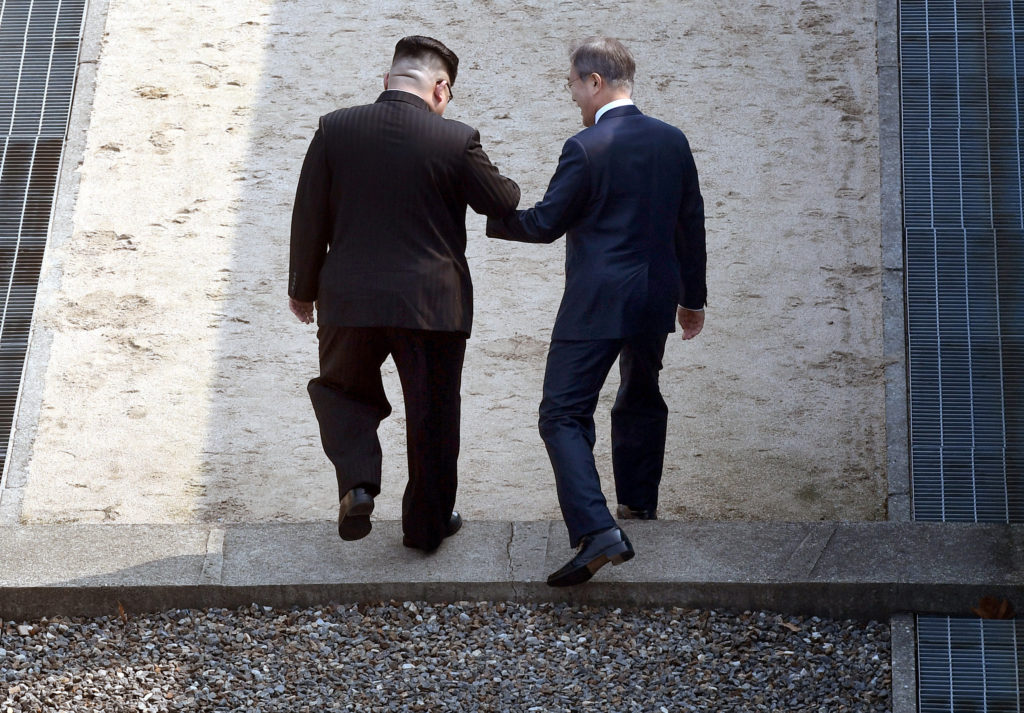 South Korean President Moon Jae-in and North Korean leader Kim Jong Un arrive at the Peace House in the truce village of Panmunjom inside the demilitarized zone separating the two Koreas South Korea
